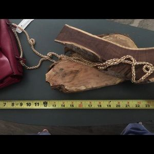 Charming Charlie new with tag's burgundy bow bag